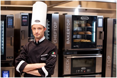UNOX Chef infront of ovens